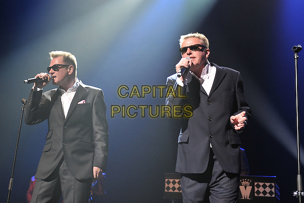 Chas Smith & Suggs of Madness.Performing live at the Royal Festival Hall as part of Ray Davies' 'Meltdown', London, England, UK, .June 17th 2011..music concert gig on stage half length sunglasses black suit white shirt microphone singing .CAP/MAR.© Martin Harris/Capital Pictures.