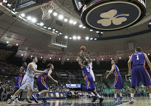 November 10, 2012:  Notre Dame guard Eric Atkins (0) goes up for a shot as Evansville guard Troy Taylor (5) defends during NCAA Basketball game action between the Notre Dame Fighting Irish and the Evansville Purple Aces at Purcell Pavilion at the Joyce Center in South Bend, Indiana.  Notre Dame defeated Evansville 58-49.