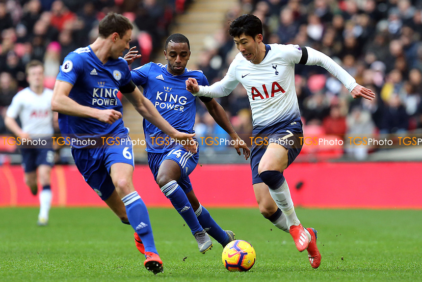 Son Heung-Min of Tottenham Hotspur and Jonny Evans of Leicester City during Tottenham Hotspur vs Leicester City, Premier League Football at Wembley Stadium on 10th February 2019