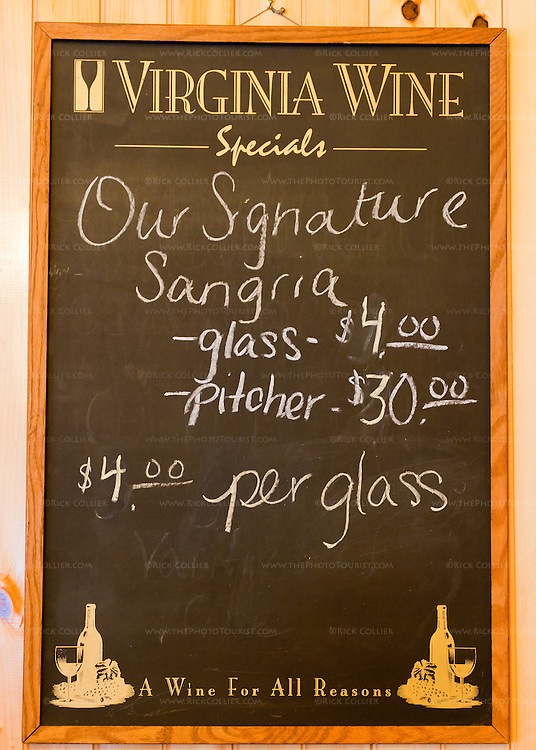A chalkboard sign offers the winery's refreshing mixed drink at DeVault Family vineyards.