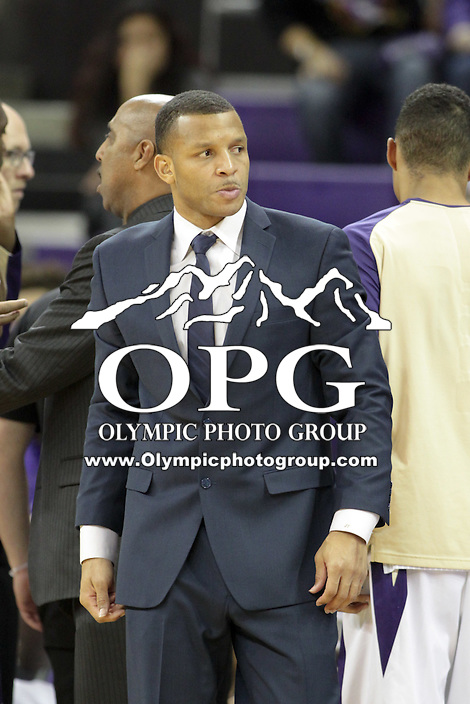 DEC 22, 2015:  Washington assistant coach Will Conroy against Seattle University. Washington defeated Seattle University 79-68 at Alaska Airlines Arena in Seattle, WA.