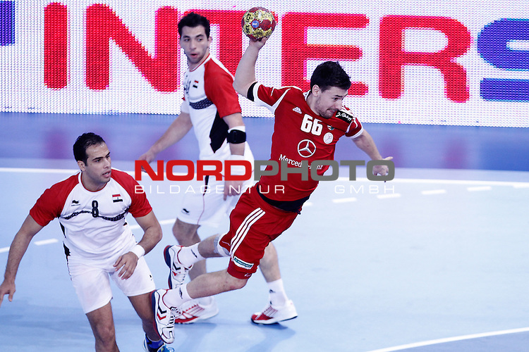 Hungary's Mate Lekai (r) and Egypt's Mohamed Ahmed during 23rd Men's Handball World Championship preliminary round match.January 12 ,2013. Foto © nph / Acero)