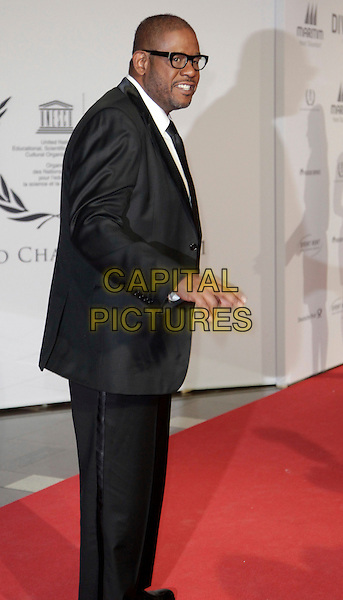 Forest Whitaker.The 20th Unesco charity gala at Maritim Hotel, Duesseldorf, Germany..November 19th, 2011.half length black suit side glasses full 3/4.CAP/PPG/JH.©Jens Hartmann/People Picture/Capital Pictures
