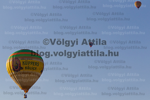 balloons fly on the sky during the Velence Lake International Hot Air Balloon Festival in Agard, Slovakia on September 10, 2011. ATTILA VOLGYI