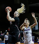 SIOUX FALLS, SD: MARCH 19: Maura D'Anna #25 of Indiana (PA) drives past Stonehill defender Samantha Hyslip #21 during their game at the 2018 Division II Women's Elite 8 Basketball Championship at the Sanford Pentagon in Sioux Falls, S.D. (Photo by Dick Carlson/Inertia)