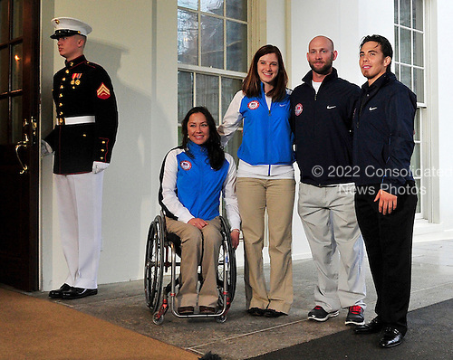 Alana Nichols, Paralympic Sit Skiier; Katherine Reutter, Olympic Speed Skater; Heath Calhoun, Paralympic Sit Skiier; and Apolo Ono, Olympic Short Track Speed Skater, pose for a group photo after meeting reporters after their meeting with United States President Barack Obama and first lady Michele Obama at the White House in Washington, D.C. on Wednesday, April 21, 2010..Credit: Ron Sachs / Pool via CNP
