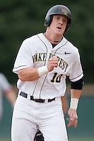 Allan Dykstra (10) of the Wake Forest Demon Deacons hustles into third base versus the Florida State Seminoles at Gene Hooks Stadium on the campus of Wake Forest University in Winston-Salem, NC, Friday, March 28, 2008.