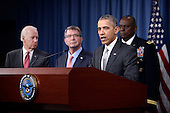 United States President Barack Obama delivers a statement on the counter-ISIL campaign in the Pentagon briefing room December 14, 2015 in Arlington, Virginia. President Obama met previously with a National Security Council on the counter-ISIL campaign. Pictured from left, US Vice President Joe Biden, US Secretary of Defense Ash Carter, and Commander of US Central Command General Lloyd Austin.<br /> Credit: Olivier Douliery / Pool via CNP