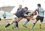 Westport's Michael Ryder makes a covering tackle on Galwegians Jack Dinneen during the junior cup final.<br /> Pic Conor McKeown