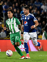 BOGOTA - COLOMBIA - 18 – 02 - 2018: Matias de los Santos (Der.) jugador de Millonarios disputa el balón Dayro Moreno (Izq.) jugador de Atletico Nacional, durante partido de la fecha 4 entre Millonarios y por la Liga Aguila I 2018, jugado en el estadio Nemesio Camacho El Campin de la ciudad de Bogota. / Matias de los Santos (R) player of Millonarios vies for the ball with Dayro Moreno (L) player of Atletico Nacional, during a match of the 4th date between Millonarios and Atletico Nacional, for the Liga Aguila I 2018 played at the Nemesio Camacho El Campin Stadium in Bogota city, Photo: VizzorImage / Luis Ramirez / Staff.
