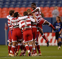 FC Dallas players celebrate Roberto Mina's goal. The Colorado Rapids and FC Dallas played to a 2-2 draw at Invesco Field at Mile High Stadium in Denver, CO, April 15, 2006.