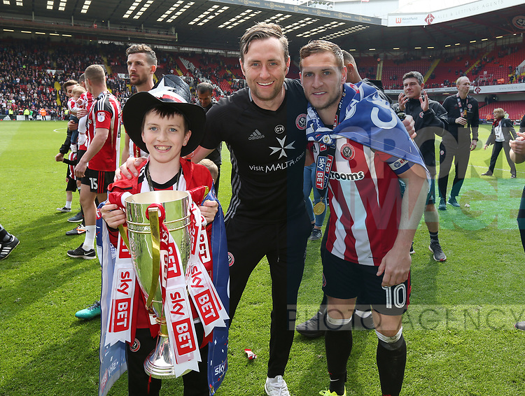 Sheffield United's Billy Sharp celebrates with Carl Hopwood with the trophy during the League One match at Bramall Lane, Sheffield. Picture date: April 30th, 2017. Pic David Klein/Sportimage