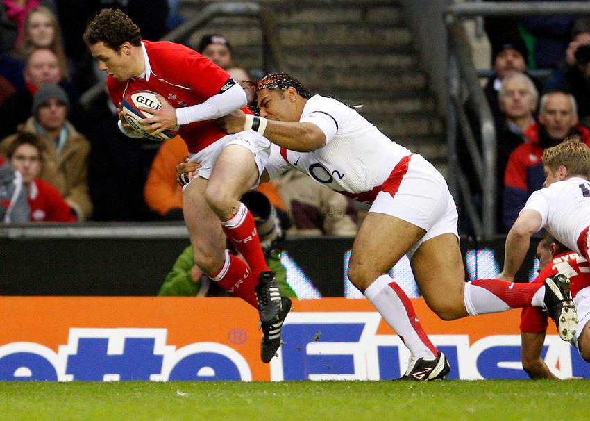 Photo: Richard Lane/Richard Lane Photography. ..England v Wales. RBS Six Nations. 02/02/2008. Wales' Mark Jones is tackled by England's Lesley Vianikolo.