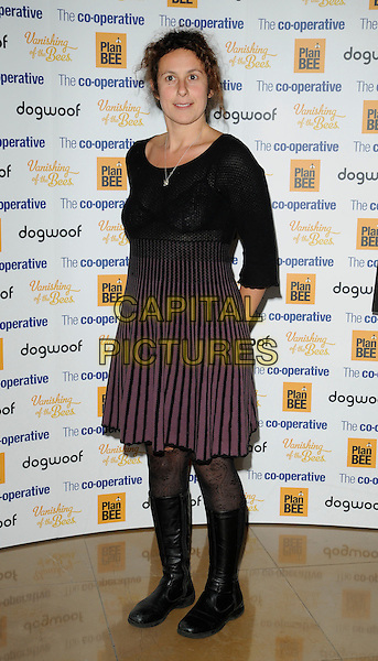 "SAM RODDICK .At the ""Vanishing Of The Bees"" World Premiere, Mayfair Hotel, London, England, UK, October 1st 2009..full length black knitted sweater jumper dress pink striped knee high boots purple .CAP/CAN.©Can Nguyen/Capital Pictures"