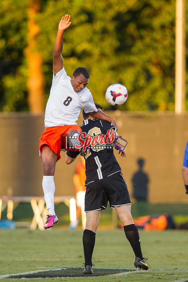 Jordan Allen (8) of the Virginia Cavaliers battles for a jump ball with Ian Harkes (16) of the Wake Forest Demon Deacons at Spry Soccer Stadium on September 13, 2013 in Winston-Salem, North Carolina.  The Demon Deacons defeated the Cavaliers 3-2.  (Brian Westerholt/Sports On Film)
