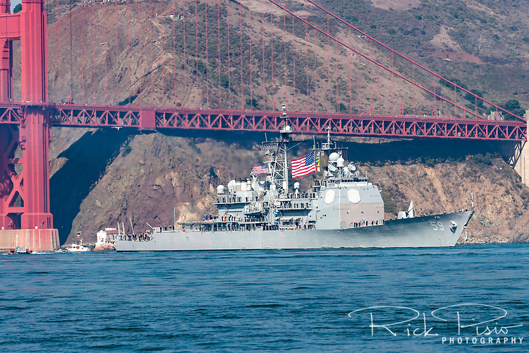 With its crew lining the decks the USS Princeton (CG 59) passes under the north end of the Golden Gate Bridge as she leads the parade of ships during San Francisco's 2006 Fleet Week activities. The Ticonderoga class guided missile cruiser is the sixth U. S. Navy ship to honor the name Princeton. It was commissioned in 1989 in Pascagoula, MS and has completed three deployments to the Arabian Gulf and won two consecutive Battle Efficiency Awards in 1992-1993.