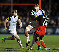 Tom Ellis of Bath Rugby is tackled by Duncan Taylor of Saracens. Aviva Premiership match, between Saracens and Bath Rugby on January 30, 2016 at Allianz Park in London, England. Photo by: Patrick Khachfe / Onside Images