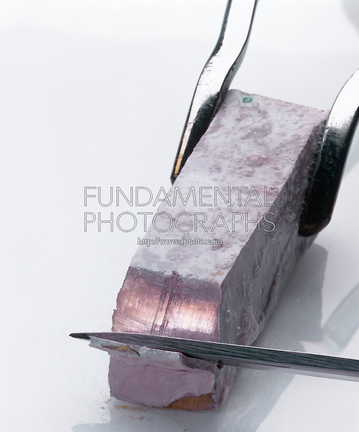 SODIUM METAL CUT WITH KNIFE<br /> Has Silvery Appearance When Freshly Cut<br /> Sodium quickly tarnishes as it is exposed to air.