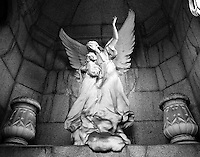 A well preserved sculpture decorates a crypt in the Cementario de la Recoleta in buenos Aires.