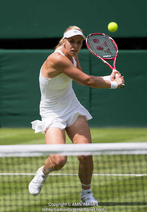 SABINE LISICKI (GER)<br /> <br /> The Championships Wimbledon 2014 - The All England Lawn Tennis Club -  London - UK -  ATP - ITF - WTA-2014  - Grand Slam - Great Britain -  24th June 2014. <br /> <br /> &copy; AMN IMAGES