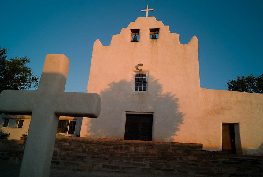 The mission church at Laguna Pueblo, New Mexico, features 18th-century art at its altar. Laguna was one of the Pueblo missions mentioned in Willa Cather's noted novel Death Comes for the Archbishop, a fictionalized account of the life of New Mexico's first archbishop Jean Baptiste Lamy, who presided in Santa Fe in the 1850s. (Kevin Moloney for the New York Times)