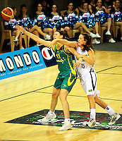 Ferns centre Kim Barnes pressures Elyse Penaluna during the International women's basketball match between NZ Tall Ferns and Australian Opals at Te Rauparaha Stadium, Porirua, Wellington, New Zealand on Monday 31 August 2009. Photo: Dave Lintott / lintottphoto.co.nz