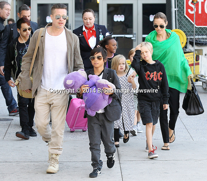 Pictured: Brad Pitt, Angelina Jolie, Shiloh Nouvel Jolie-Pitt, Maddox Chivan Jolie-Pitt, Pax Thien Jolie-Pitt, Knox Leon Jolie-Pitt, Zahara Marley Jolie-Pitt, Vivienne Marcheline Jolie-Pitt<br /> Mandatory Credit &copy; Ben Foster/Broadimage<br /> Brad Pitt, Angelina Jolie and family arriving at the Los Angeles International Airport<br /> <br /> 2/5/14, Los Angeles, California, United States of America<br /> <br /> Broadimage Newswire<br /> Los Angeles 1+  (310) 301-1027<br /> New York      1+  (646) 827-9134<br /> sales@broadimage.com<br /> http://www.broadimage.com<br /> <br /> <br /> Pictured: Brad Pitt, Angelina Jolie, Shiloh Nouvel Jolie-Pitt, Maddox Chivan Jolie-Pitt, Pax Thien Jolie-Pitt, Knox Leon Jolie-Pitt, Zahara Marley Jolie-Pitt, Vivienne Marcheline Jolie-Pitt<br /> Mandatory Credit &copy; Ben Foster/Broadimage<br /> Brad Pitt, Angelina Jolie and family arriving at the Los Angeles International Airport<br /> <br /> 2/5/14, Los Angeles, California, United States of America<br /> Reference: 020514_HDLA_BDG_017<br /> <br /> Broadimage Newswire<br /> Los Angeles 1+  (310) 301-1027<br /> New York      1+  (646) 827-9134<br /> sales@broadimage.com<br /> http://www.broadimage.com