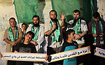 Palestinian Hamas supporters take part in a protest against the demolition of  Palestinian buildings in the the Palestinian village of Sur Baher, in Gaza city July 22, 2019. Israel demolished a number of Palestinian homes it considers illegally constructed near its separation barrier south of Jerusalem on July 22, in a move that drew international condemnation. Palestinian leaders slammed the demolitions in the Sur Baher area which straddles the occupied West Bank and Jerusalem. Photo by Mahmoud Naser