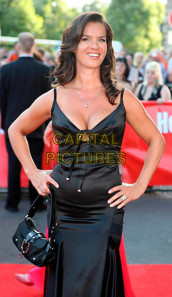 KATARINA WITT.Attending the 15th BILD OSGAR Verleihung, New City Hall ( Neuen Rathaus ) Leipzig, Germany,. 24th June 2008..half length black dress hand on hip bag cleavage tied .CAP/PPG.©Willi Schneider/People PIcture/Capital Pictures