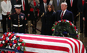 U.S. President Donald Trump and First Lady Melania Trump pay their respects at the casket of former U.S. President George H.W. Bush as it lies in state inside the U.S. Capitol Rotunda on Capitol Hill in Washington, U.S., December 3, 2018. REUTERS/Jonathan Ernst/Pool