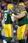 Kicker Ryan Longwell #8 and offensive lineman Mark Tauscher #65 of the Green Bay Packers celebrate the winning field goal against the Detroit Lions at Lambeau Field on December 12, 2004 in Green Bay, Wisconsin. The Packers defeated the Lions 16-13. (Photo by David Stluka)