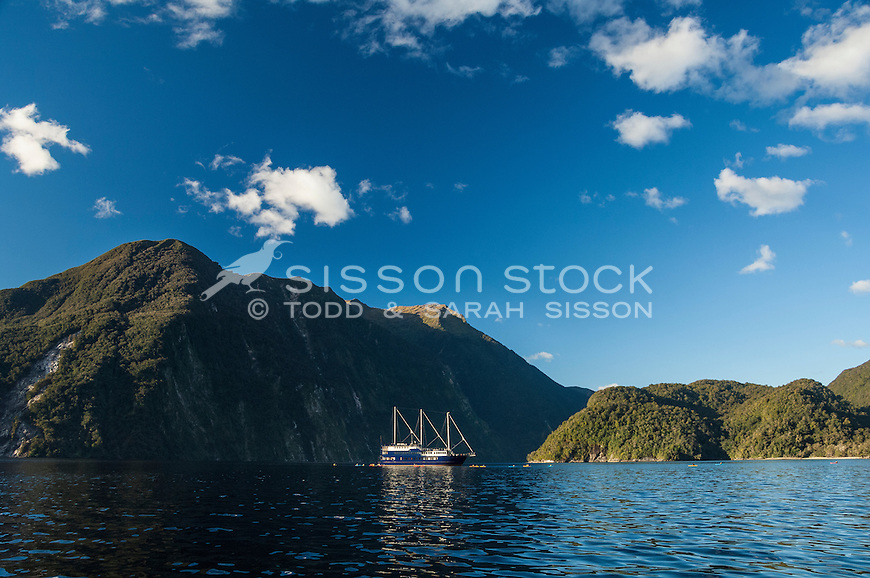 The Fiordland Navigator surrounded by kayaks in Doubtful Sound, Fiordland National Park, South Island, New Zealand - stock photo, canvas, fine art print
