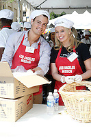 April 2, 2010: Tiffany Thornton and Gregory Michael at the LA Mission Easter Luncheon event for the homeless in Los Angeles, California. .Photo by Nina Prommer/Milestone Photo.