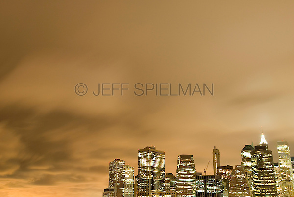 Skyline of Lower Manhattan's Financial District, Illuminated at Dusk on an Overcast, Cloudy Evening, New York City, New York State, USA