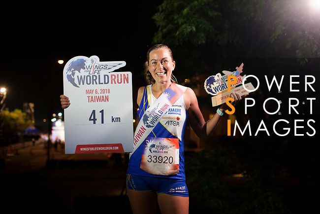 Frida Sodermark of Sweden poses with the trophy after winning The Wings for Life World Run along Taoyuan district on Sunday, May 6, 2018 in Taiwan. Photo by Fernando Banos / Power Sport Images