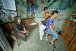 A man gets a haircut at a barber in Tuingo, an ethnic Chin village in Myanmar.