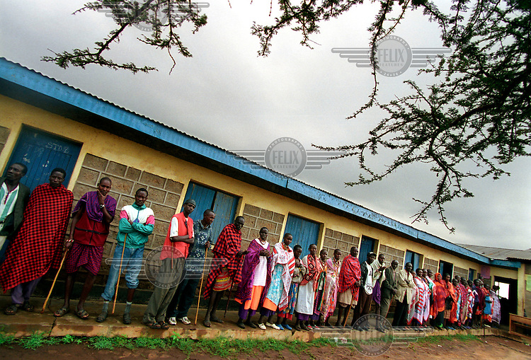 Masai people queue up outside a polling station in Kajiado district. Mwai Kibaki won a landslide victory, seeing off his Kanu rival Uhuru Kenyatta. The poll marked the end of Daniel arap Moi's 24-year rule and the Kanu party's four decades in power.