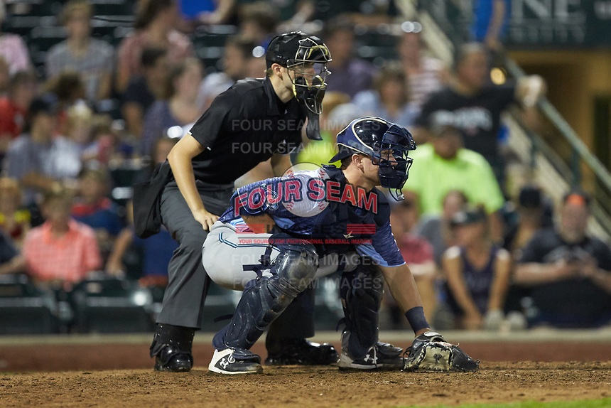 West Michigan Whitecaps catcher Cooper Johnson (37) on defense as home plate umpire Nathan Diederich looks on during the game against the Fort Wayne TinCaps at Parkview Field on August 5, 2019 in Fort Wayne, Indiana. The TinCaps defeated the Whitecaps 9-3. (Brian Westerholt/Four Seam Images)