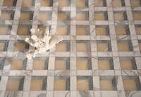 Paseo, a handmade mosaic shown in polished Cream Onyx, honed Allure, and honed Calacatta, was designed by Paul Schatz as part of the Illusions® collection by New Ravenna.