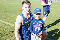 Picture by Brendon Ratnayake/SWpix.com - 14/02/2018 - Rugby League - Dacia World Club Challenge - Melbourne Storm v Leeds Rhinos - Gosch's Paddock, Melbourne, Australia - A young fan takes a photo with Tom Briscoe of Leeds Rhinos