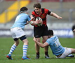 Eldon Nolan of Ennis  in action against James Jones and Harry Byrne of Garryowen during their U-18 Munster Club Final at Thomond Park. Photograph by John Kelly.