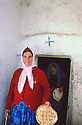 Turkey 1995.In Midin, one of the last Syriac Christian village of Tour Abdin, end of the sunday mass, women coming out of the church with holy bread.Turquie 1995.A Midin, l'un des derniers villages chretiens de la region de Tour Abdin, sortie de la messe du dimanche, des femmes avec du pain beni