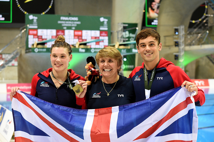 Great Britain's Tom Daley and Grace Reid with their coach Jane Figueiredo after winning gold during the mixed 3m Synchro Springboard <br /> <br /> Photographer Hannah Fountain/CameraSport<br /> <br /> FINA/CNSG Diving World Series 2019 - Day 3 - Sunday 19th May 2019 - London Aquatics Centre - Queen Elizabeth Olympic Park - London<br /> <br /> World Copyright © 2019 CameraSport. All rights reserved. 43 Linden Ave. Countesthorpe. Leicester. England. LE8 5PG - Tel: +44 (0) 116 277 4147 - admin@camerasport.com - www.camerasport.com