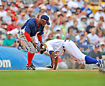 12 March 2008: Los Angeles Dodgers' outfielder Juan Pierre dives safely into third ahead of the attempted tag by Willie Harris during a Spring Training game against the Washington Nationals at Holman Stadium, in Vero Beach, Florida. The Nationals defeated the Dodgers 10-4 at the historic Dodgertown ballpark. 2008 marks the final season of Spring Training at Dodgertown for the Dodgers, as the team will move to new training facilities in Arizona starting in 2009 after 60 years in Florida...Mandatory Photo Credit: Ed Wolfstein Photo