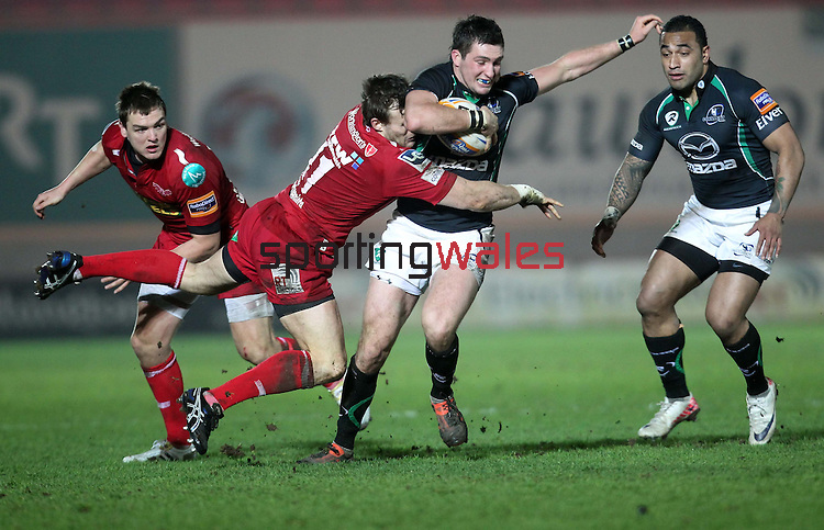 Andy Fenby tackles Dave McSharry..RaboDirect Pro12.Scarlets v Connacht.02.03.12.©STEVE POPE