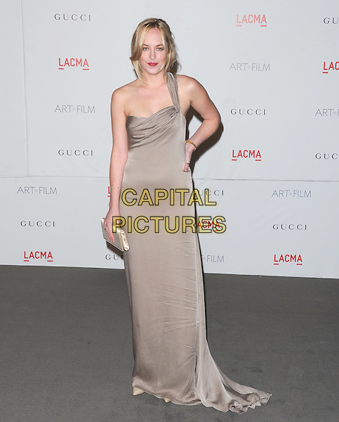 Dakota Johnson.The Inaugural Art and Film Gala held at LACMA in Los Angeles, California, USA..November 5th, 2011   .full length beige dress hand on hip one shoulder .CAP/RKE/DVS.©DVS/RockinExposures/Capital Pictures.