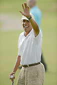 United States President Barack Obama waves to people waiting at the 18th hole at the Mid Pacific Country Club in Lanikai, Hawaii on January 1, 2014.<br /> Credit: Cory Lum / Pool via CNP