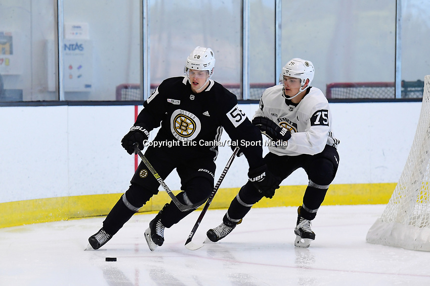 June 26, 2018: Boston Bruins defenseman Urho Vaakanainen (58) and forward Henry Bowlby (75) skate during the Boston Bruins development camp held at Warrior Ice Arena in Brighton Mass. Eric Canha/CSM