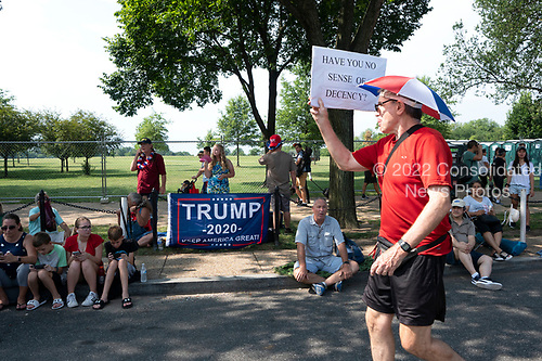 A protestor walks the Independence Day Parade route prior to the parade along Constitution Avenue in Washington DC on July 4, 2019.<br /> <br /> Credit: Stefani Reynolds / CNP