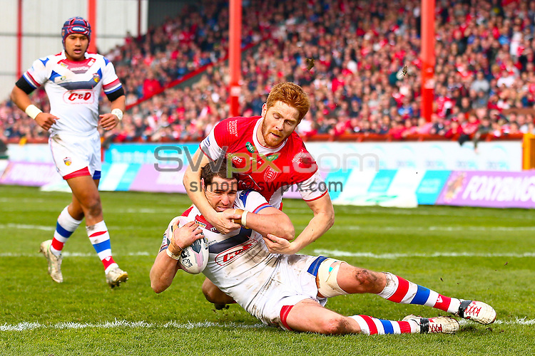 Picture by Alex Whitehead/SWpix.com - 30/03/2014 - Rugby League - First Utility Super League - Hull Kingston Rovers v Wakefield Trinity Wildcats - KC Lightstream Stadium, Hull, England - Wakefield's Dean Collis is tackled by Hull KR's Kris Welham.